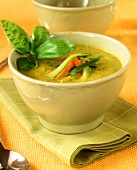 Courgette soup with carrots and basil