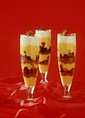Trifle with vanilla cream, berries & sponge in custard