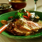Roast lamb with vegetables and mint jelly