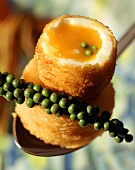 Peppered egg: breaded soft-boiled egg with green peppercorns