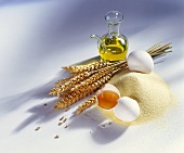 Still life with semolina, eggs, cereal ears and olive oil