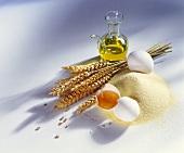 Stillleben mit Griess, Eiern, Ähren und Olivenöl