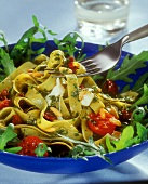Ribbon pasta with ramsons pesto, tomatoes & pine nuts