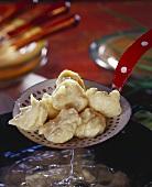 Schwemmklösschen (boiled dumplings from Lower Bavaria) on ladle