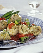 Ramsons (wild garlic) dumplings with tomatoes and rocket