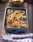 Baked potato noodles with white cabbage and ham