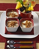 Vanilla quark with chocolate curls; fruit kebabs