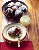 Yeasted chocolate rolls with plums and custard