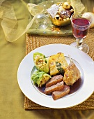 Duck with savoy rolls and potato gratin