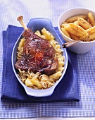 Goose leg with pineapple sauerkraut; potato noodles