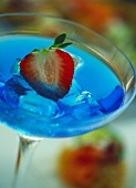Cocktail with Blue Curacao and strawberry