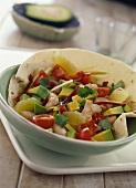 Tortilla with shrimp and avocado salad