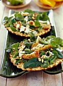 Flatbreads with spinach, chicken and pine nuts