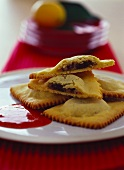 Ravioli with chocolate filling and strawberry sauce