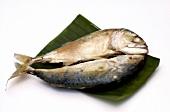 Steamed saltwater fish on banana leaf