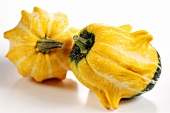 Two yellow and green squashes