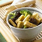 Asparagus with tofu, jelly ear fungus and broccoli (China)