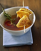Chicken broth with Parmesan croutons and cherry tomatoes