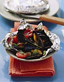 Barbecued mussels in aluminium foil