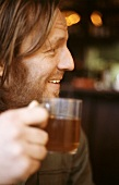 Man with a glass of tea in restaurant