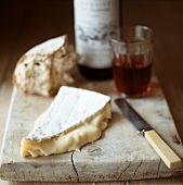 Piece of Brie, bread and red wine