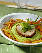 Roast turkey roll on pea puree with carrots