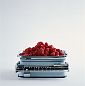 Fresh raspberries on kitchen scales
