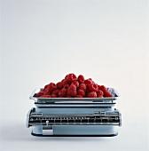 Fresh raspberries on kitchen scales