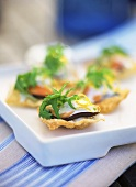 Scallop with aubergine and mayonnaise on wonton