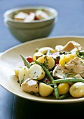 Potato salad with green beans, tomatoes and tuna