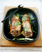 Stuffed veal roulades garnished with coriander leaves