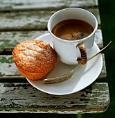 Cup of espresso and an almond tart