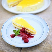A piece of lemon cream cake with raspberry sauce