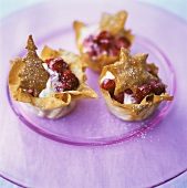 Filo pastry shells with vanilla cream and raspberries