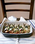 Stuffed sardine rolls with pine nuts