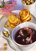Almond potato cakes with plum compote