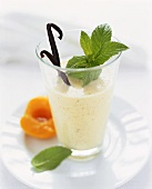 Nectarine and vanilla shake with mint leaf