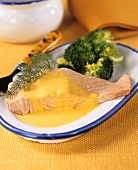 Poached salmon with saffron sauce and broccoli