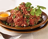 Veal tartare with egg, onions and herbs