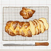Bread plait with sugar, slices cut, on cake rack