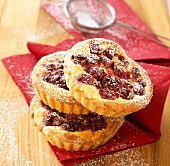Cherry tarts with icing sugar