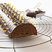 Saddleback cake with slivered almonds on cake rack