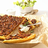 Pizza with mince and sour cream (Turkey)