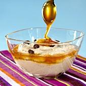 Coconut cream with raisins and honey