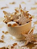 Cinnamon stars with icing sugar in white bowl