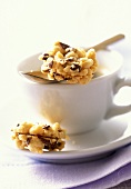Crumble biscuit on white coffee cup
