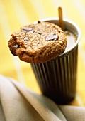 Chocolate chip cookie on a mug of coffee