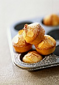 Mini-muffins with almonds and icing sugar