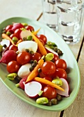 Raw vegetable salad with mozzarella and capers