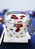 Yoghurt with fresh berries in glass
